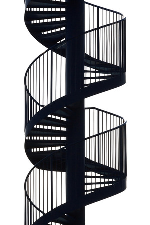 An empty spiral metal staircase on white background photo