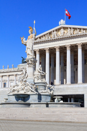 pallas: Facade of the Austrian Parliament with a statue of  Pallas Athene in Vienna