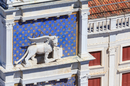 Famous winged lion of Venice on the clock tower of San Marcos square photo