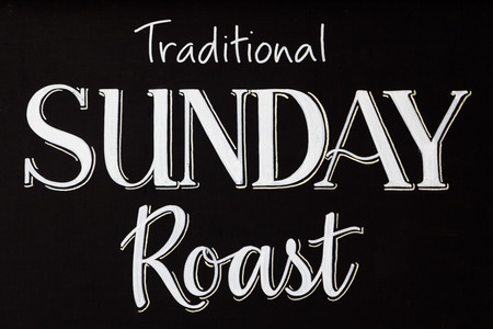roasted: Word text of traditional sunday roast written on a chalkboard