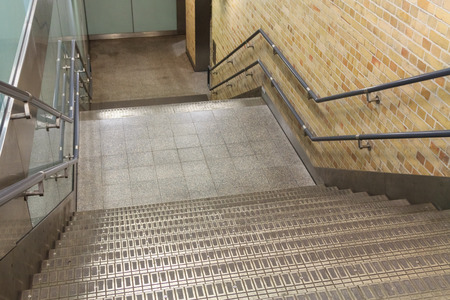downstairs: Stairs leading downstairs on a public underground station Stock Photo