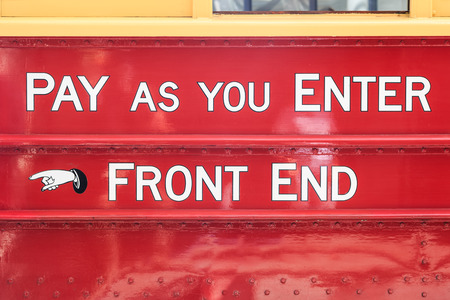 front end: Text on an old touristic tram in Christchurch, New Zealand: pay as you enter - front end Stock Photo