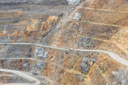 martha: Bottom of surface mining and machinery in an open pit mine in Waihi, New Zealand