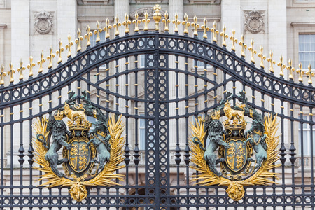 Golden coat of arms at the main Buckingham Palace gate in London
