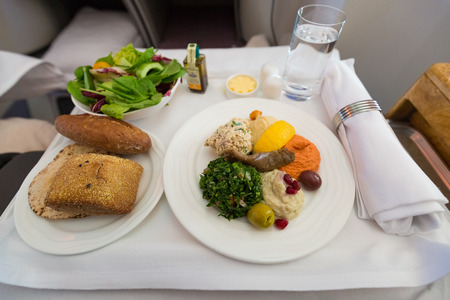 Arabic mezze as appetizers on a business class seat in a plane