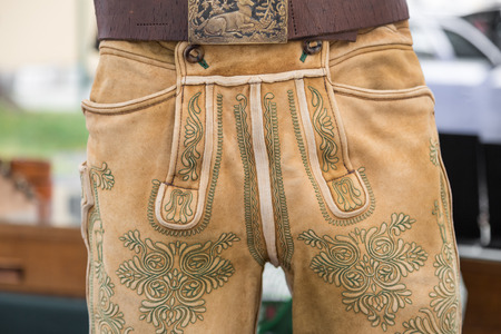 lederhose: Classic green manual embroidery on traditional deerskin leather trousers from Salzkammergut, Austria Stock Photo
