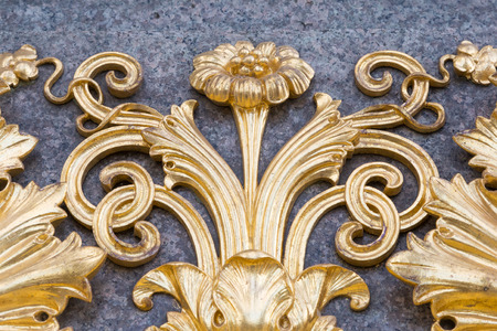 craft on marble: Golden dirty floral ornament on marble at the Austrian Parliament in Vienna Stock Photo