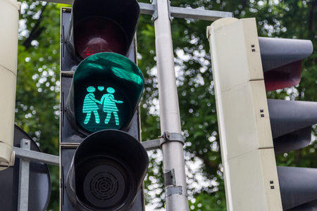 themed: A green gay themed Vienna traffic light Stock Photo