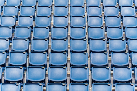 seating: Stadium seating with blue folded up chairs Stock Photo
