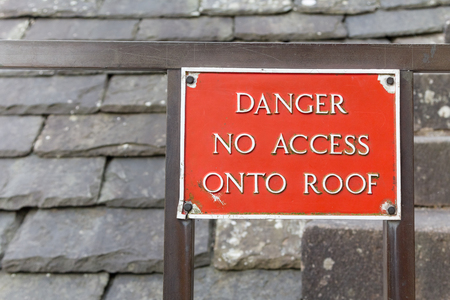 no access: A red sign saying danger no access onto roof