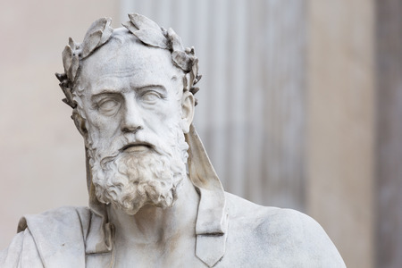 ancient philosophy: Portrait of the stone statue of greek philosopher Xenophon in front of the austrian parliament in Vienna Stock Photo