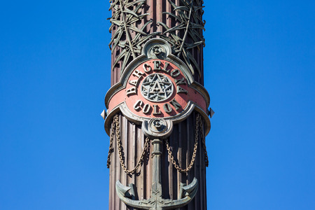 colom: A closeup of the middle of the famous colon with Christoph Columbus on top in Barcelona, Spain