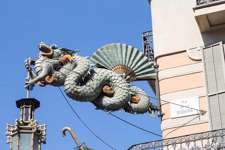rambla: Chinese dragon on house of umbrellas (Casa Bruno Cuadros) building on La Rambla in Barcelona, Catalonia, Spain
