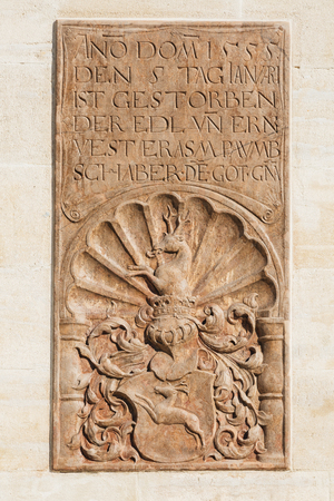 obituary: Obituary with coat of arms on a wall of monastery Klosterneuburg in Austria