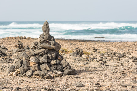 Stones piled up on a rocky beach in Fuerteventura, Spain Imagens
