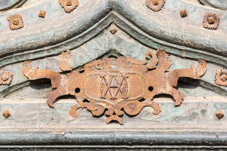 Detail of a rusty metal plaque on the portal of the cathedral in Girona