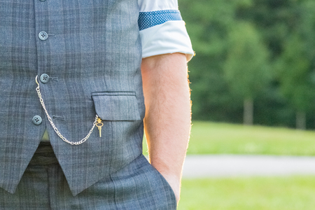 Elegant gentlemans suit with chain and key for traditional pocket watch