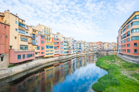Poor colorful buildings with Casa Maso at river Onyar in Girona, Spain
