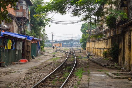 Raiilroad tracks in the middle of Hanoi, Vietnam, leading to the main train station Imagens