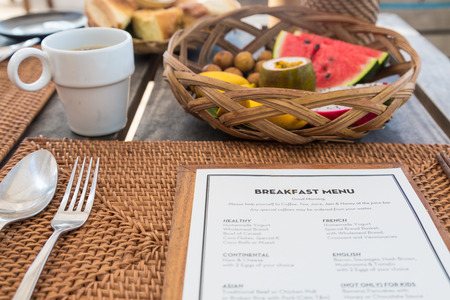 Breakfast menu with fruit basket and deck in a restaurant on Phu Quoc island Imagens