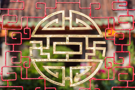 longevity: Stylized chinese characters made into a round vietnamese symbol for blessings like happiness, luck and longevity in front of a temple in Hoi An, Vietnam