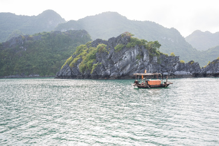 A small local fisher boat in Halong Bay, Vietnam