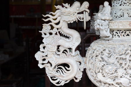 Detail of an ornate handle in the shape of a dragon on an asian vase in Sapa, Vietnam
