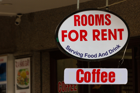 Sign for rooms for rent and serving food and drink on a building in Hanoi, Vietnam