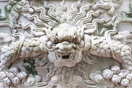 Marble carved demon on a wall at marble mountain, Da Nang, Vietam Imagens
