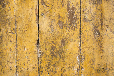 Weathered yellow paint on wooden planks Imagens - 84773802