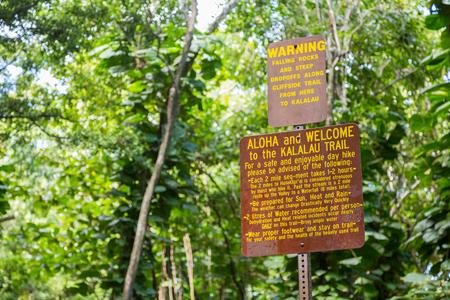Signs before Kalalau trail on the island Kauai, Hawaii