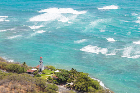 Lighthouse at the coast of Oahu near Diamond Head, Honolulu Imagens - 89705346