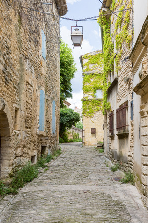 Narrow street in the medieval village Gordes in Provence, France