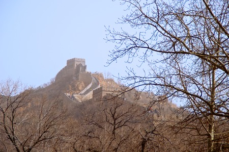 The Great Wall of China Beyond Barren Trees In The Foreground