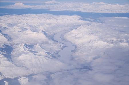 A Frozen River Running Through Ice And Snow In Alaska Banco de Imagens