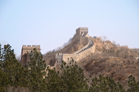 The Great Wall of China With Evergreen Trees In The Foreground