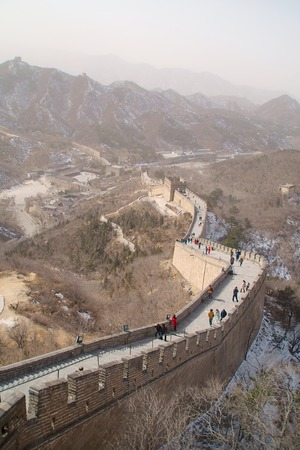 The Great Wall Of China With Snowy Mountains In The Background 写真素材