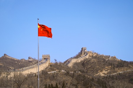 The Chinese Flag Before The Great Wall Of China