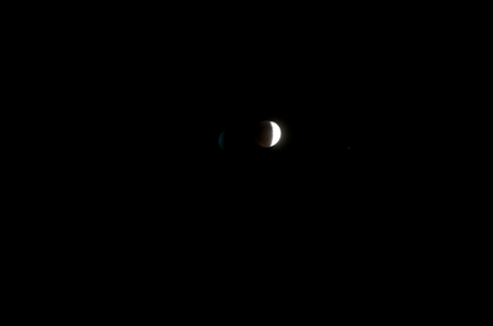 crescent: April 14, 2014 (4142014) - Partial Blood Moon Lunar Eclipse With Lens Flare Editorial
