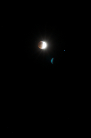 penumbra: April 14, 2014 (4142014) - Partial Blood Moon Lunar Eclipse With Starbursts And Lens Flare Editorial