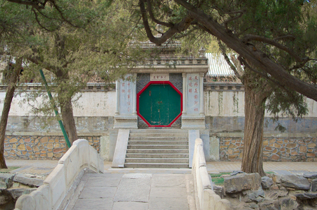 Pathway Leading To A Traditional Chinese Door Separating Areas Of The Summer Palace In Beijing