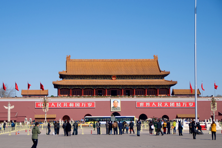 A Crowd Of Chinese Resident Visitors and Tourists Standing Before The Mausoleum of Mao Zedong in Tiananmen Square in Beijing, China