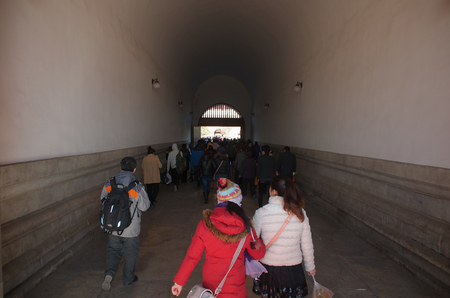 Chinese People And Tourists Walking Through The Tiananmen Gate Into The Forbidden City In Beijing, China Editorial