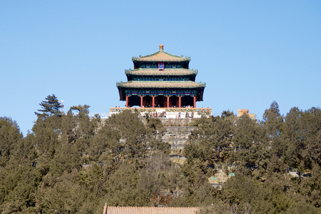 A Distant Chinese Pagoda In Jinshan Park Beyond The Trees Within The Forbidden City In Beijing, China Editorial