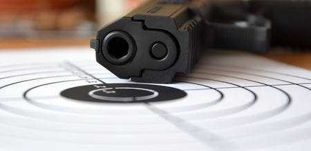 automatic pistol: Gun and target, macro with small depth of field Stock Photo