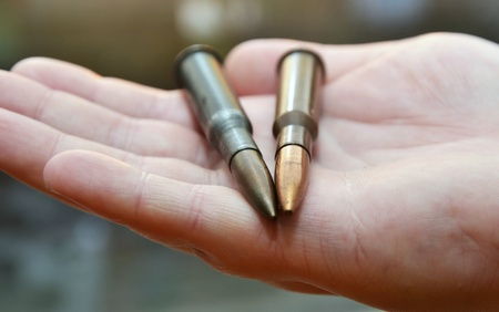 45 caliber: Mix of bullets in hand, military ammunition  Stock Photo