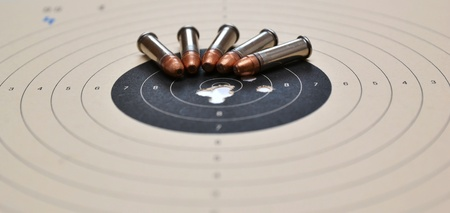 Detail on holes in target and ammunition Stock Photo - 12940334