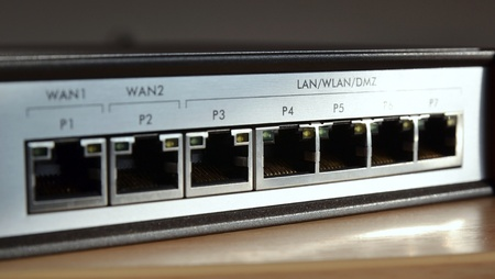 Network switch for connecting cables, close up on ports Stock Photo - 12940395