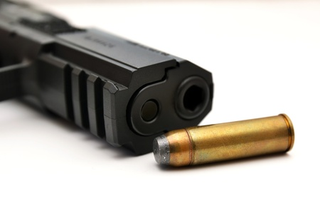 Detail of gun and ammunition, handgun and bullet Stock Photo - 12940320