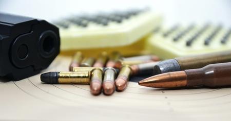 ammunition: Detail of gun and ammunition, handgun and mix of bullets